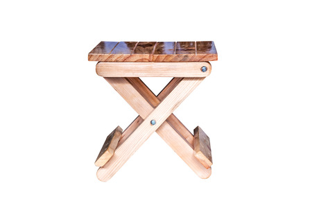 stool: Small wooden folding stool on white background