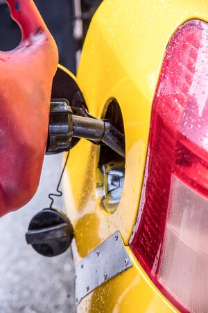emergency vehicle: Emergency vehicle refueling, pouring fuel into gas tank from gas canister. Stock Photo