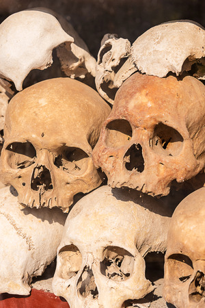 Pile of human skulls on a wat thmei at Siem Reap, Cambodia.