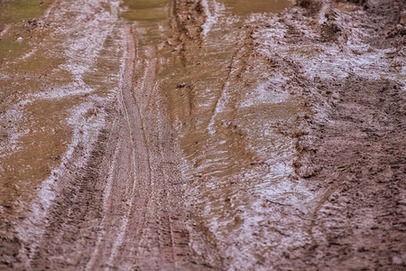 routing: Tire tracks on a muddy road in the rural, Routing traffic at countryside.