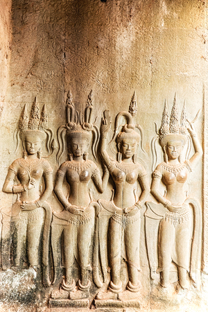 cambodia sculpture: Apsara sculpture on the wall of Angkor Wat, Seam Reap, Cambodia.