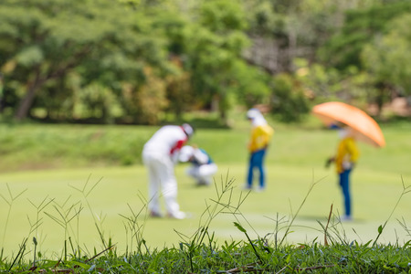 Defocus or blurred man figure playing golf on golf course, used for background.