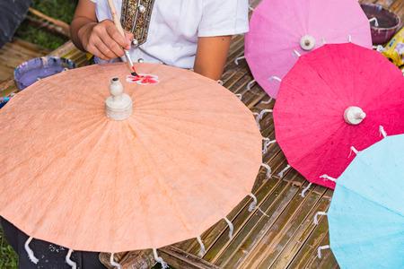 yong: Yong girl painting on Handmade umbrella of the village Bo Sang, Chiang mai, Thailand.