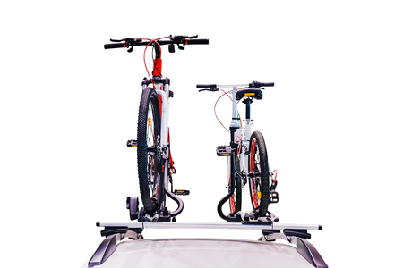 Bicycle on the roof of the car isolated on white, With clipping path. Stock Photo