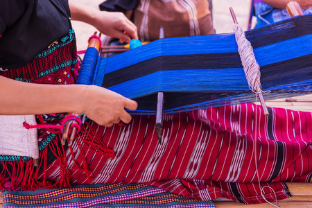 Woman Karen Tribal Weaving of traditional in thailand. Stock Photo