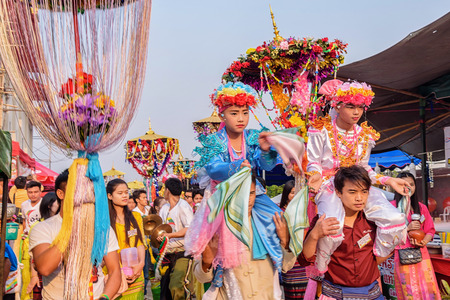 CHIANG MAI, THAILAND - MARCH 24 : Poy Sang Long festival, A Ceremony of boys to become novice monk, In parade around Koo Maan temple on March 24, 2017 in Chiang mai, Thailand.