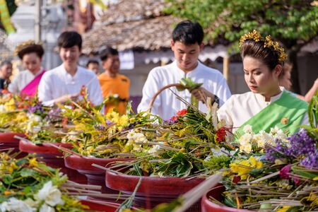 CHIANG MAI, THAILAND - MAY 22 : People worshiping offering flowers attended a ceremony to worship the city pillar (Inthakin Festival) at Chedi Luang temple on May 22, 2017 in Chiang mai, Thailand.