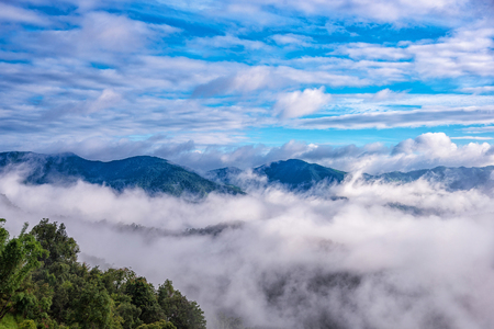 Landscape of Morning mist in the rainy season at Pee Pan Nuea, Omkoi, Chiang Mai province, north of Thailand.  Stock Photo