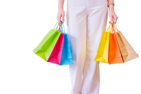 Woman with shopping bags isolated on white background, consumerism and sale concept. Stock Photo