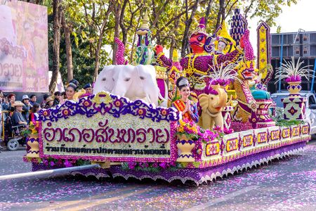 CHIANG MAI,THAILAND-FEBRUARY 02, 2019 :Unidentified peoples are in parade with fresh flowers decorate car in annual 43 th Chiang Mai Flower Festival.