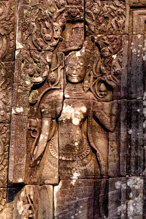 Stone carvings on the walls of the Bayon Temple in Angkor Thom, Siem Reap, Cambodia.