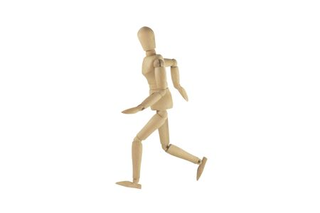 proportions of man: Wooden figure walking on white background.