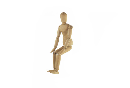 proportions of man: Wooden figure sitting on white background.