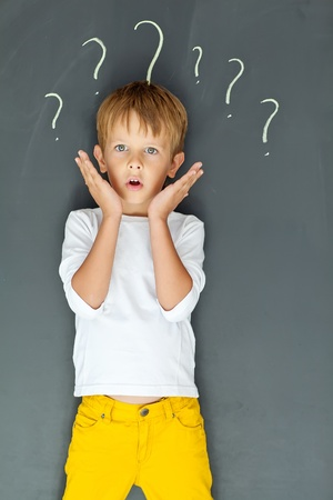 Child with many question marks photo