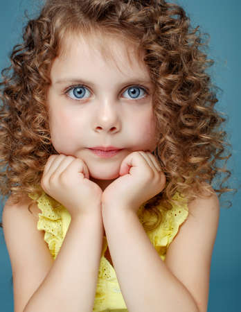 Portrait of a beautiful girl child. High quality photo.