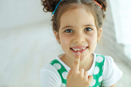 Little girl with no tooth. The child lost a tooth. High quality photo. Stock Photo