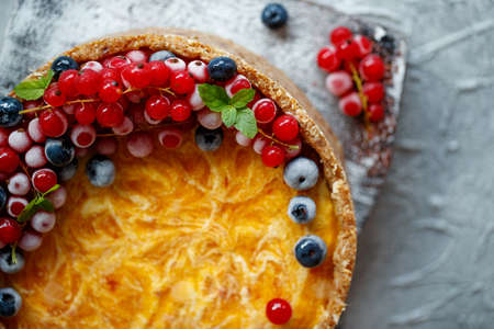 Cheesecake cake with berries. Cake with delicate curd and dough base. High quality photo.