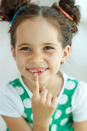 Little girl with no tooth. The child lost a tooth. High quality photo.