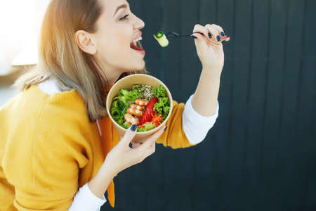 Fat woman on a diet, fresh greens salad. High quality photo. Archivio Fotografico