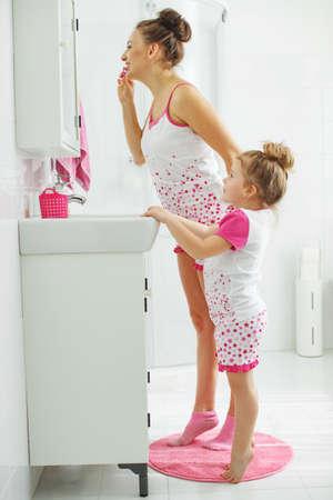 Mom and child brush their teeth. High quality photo. Archivio Fotografico