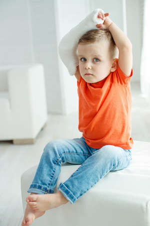 little boy in a cast.child with a broken arm. funny kid after accident. High quality photo. Banco de Imagens