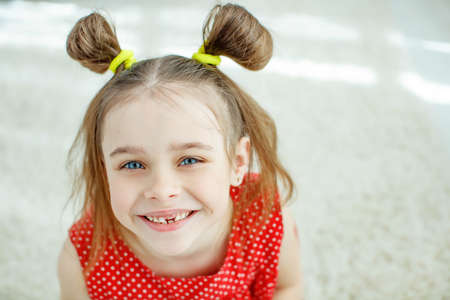 Little girl has no tooth. the child has lost a baby tooth. High quality photo Stock Photo
