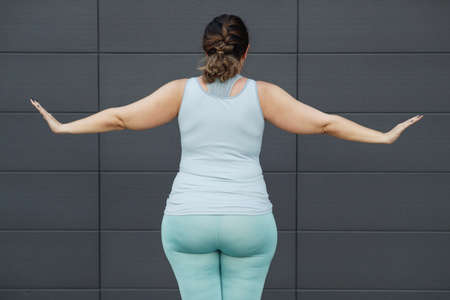 Fat sports woman goes in for sports. High quality photo. Archivio Fotografico