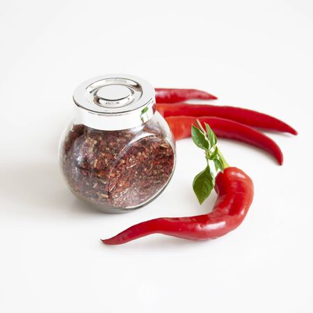 Mix of spices in a glass jar. Red chili peppers. Cooking The ingredients. Organic food