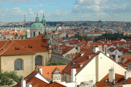 St. Nicholas Church and the red roofs in Lesser Town, Prague, Czech Republic photo