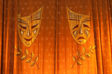 performing arts: Comedy Tragedy. Curtains with masks in the theater Stock Photo