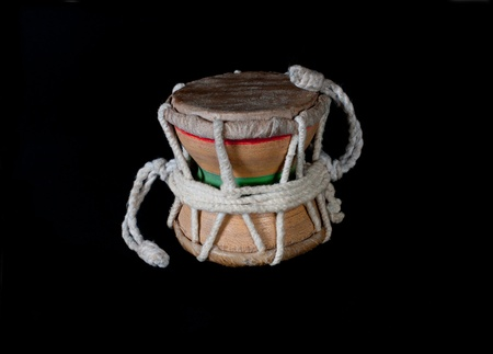 Damaru drum. Close-up. Black background Stock Photo