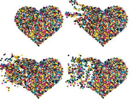 Variegated confetti heart isolated on white background photo