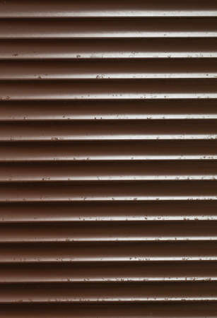 Closeup of Brown Blinds With Rain Drops photo