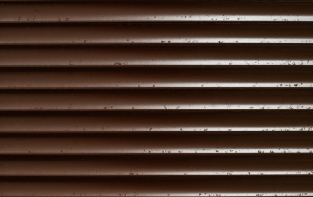 Closeup of Brown Blinds With Rain Drops