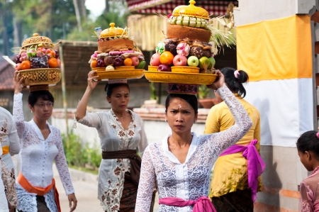 Tirta Empul, Bali, Indonesia - October 11, 2011  woman with basket on here head walking to Tirta Empul Temple to give offerings to the spirits Editorial