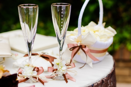 outdoor event: Pair of wedding wineglasses on the table