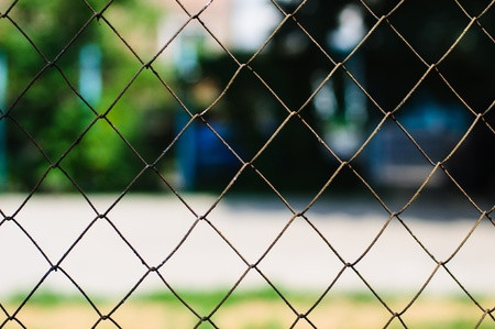 Rusted chain link fence with out of focus background Stock Photo - 14471744