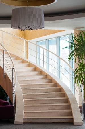 Modern staircase in hotel foyer with daylight from window Stock Photo