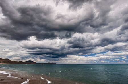 View of thunderstorm clouds above the sea photo