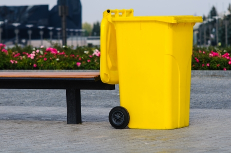 Big yellow recycling container in the park