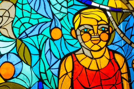 Old stained-glass window with people.