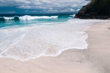 Beach with white sand. Padangbai, Bali, Indonesia.