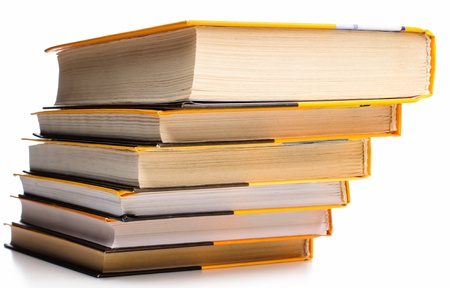 Big stack of yellow books isolated on white background photo