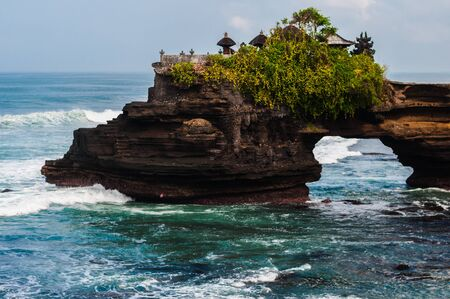 Pura Batu Bolong - small hindu temple near Tanah Lot, Bali, Indonesia Stock Photo