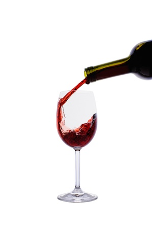 Red wine pouring into wine glass isolated on white background Stock Photo - 16646632