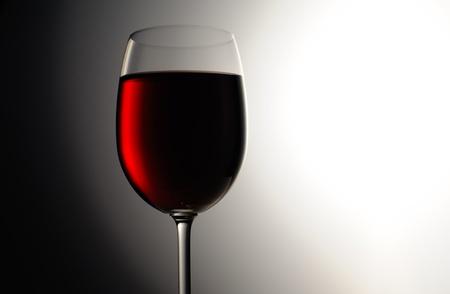Closeup of red wine wineglass on dark background Stock Photo - 16646641