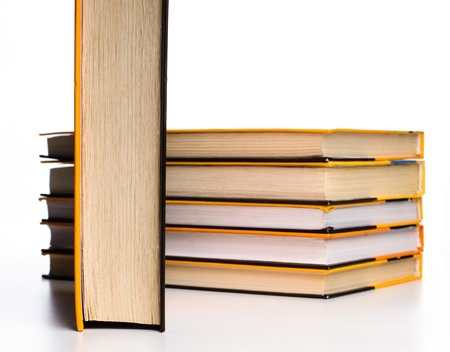 Big stack of yellow books isolated on white background