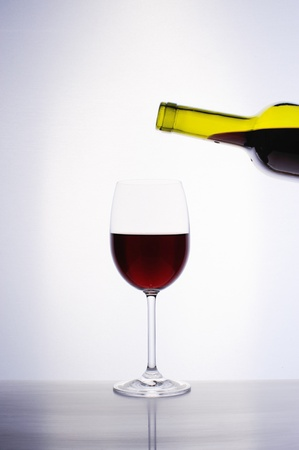Classic glass of red wine isolated on a white background Stock Photo - 16962291