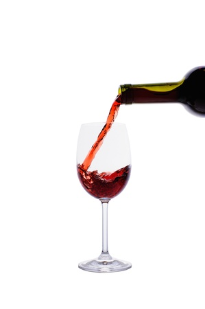 Red wine pouring into wine glass isolated on white background Stock Photo - 16962288