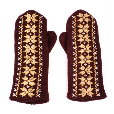 Brown woolen knitted mittens on white background photo